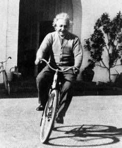 Albert Einstein on a bicycle in Niels Bohr's garden